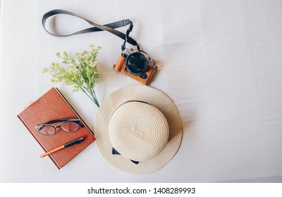 The set of travel equipment arrangement on the bed, prepare for travel. Abstract of travel and holiday background.