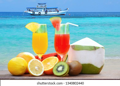 Set of tropical fruits colorful and fresh summer juice glass healthy foods / Many ripe fruit mixed on the beach blue sea background - Summer Holidays concept