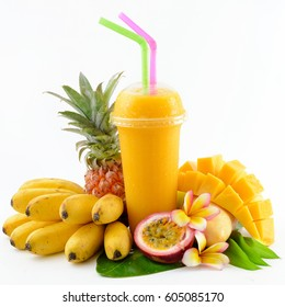 Set of tropical fruits and smoothie isolated on white