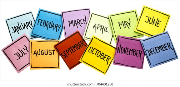 set of twelve months  (January, February, March, April, May, June, July, August, September, October, November, December) - handwriting in black ink on isolated sticky notes