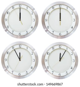 set of twelve o clock on the dial round wall clock isolated on white background