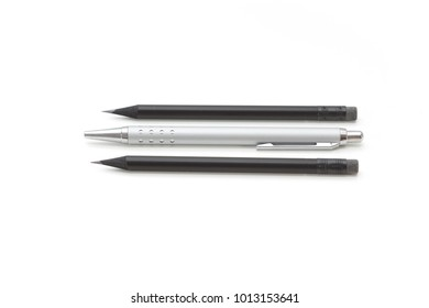 Set of two pencils and a biro on a white background