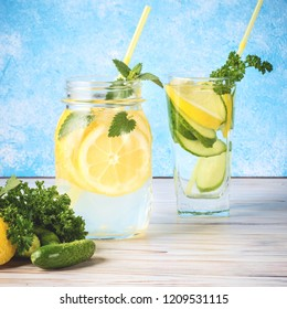 Set of two popular diet detox drinks for cleansing Antioxidant Cucumber Water and Lemonade with Mint Leaves Homemade Food Concept