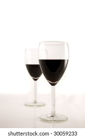 A set of two red wine glasses for a romantic encounter
