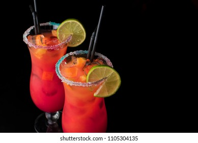 set of two summer refreshing coctails isolated on a black background. Orange alcoolic coctail or a lemonade