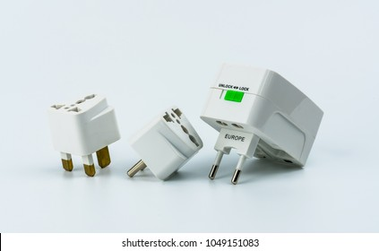 Set of universal plug adapters for travel around the world isolated on white background.