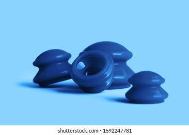 Set of vacuum blue cans for face and body on blue colored background. Rubber equipment for anti cellulite massage. Do it yourself manual slimming lymphatic drainage and anticellulite massage