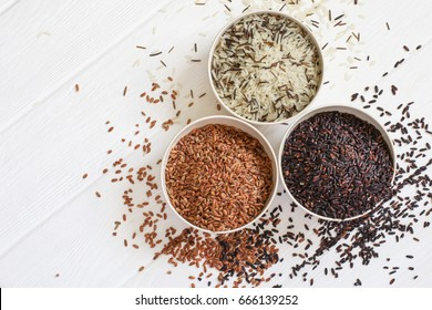 Set of variety of gourmet rice in bowls. Top view with copy space