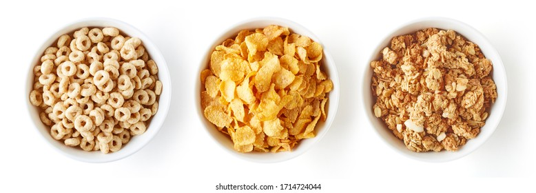 Set of various breakfast cereals isolated on white background, top view