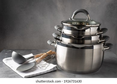 set of various cookware and utensils on dark background. recipe book, cooking classes concept. space for text