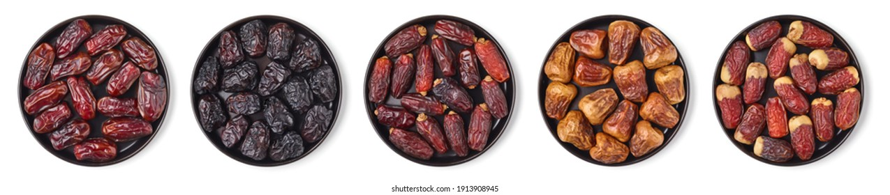 Set of various dates on black plate isolated on white background; top view