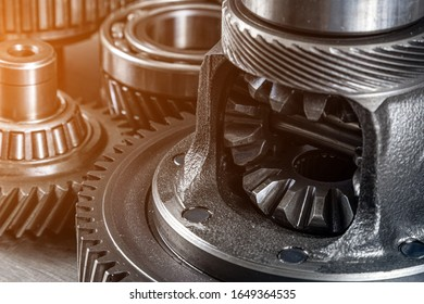 Set of various engine and gearbox spare parts. Shiny gears for planetary gearbox.Metal  autotechnology background. differential gears, close up