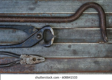 Set of various equipment, instruments and tools for manual work with copy space, carpenter tool old rusty metal background.