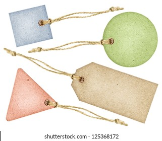 Set of various grungy color aged paper tags with metal rivets and simple traditional strings, isolated over white background