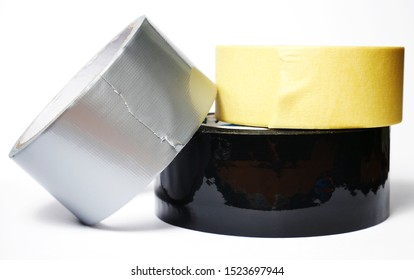 Set of various isolated adhesive tapes on a white background. Gray reinforced adhesive tape, mounting adhesive tape, black adhesive tape.