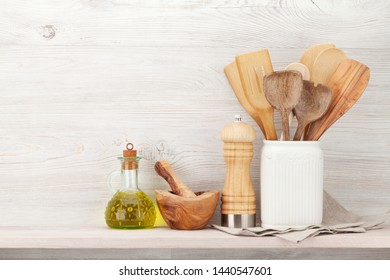 Set of various kitchen utensils. In front of wooden wall with copy space for your text