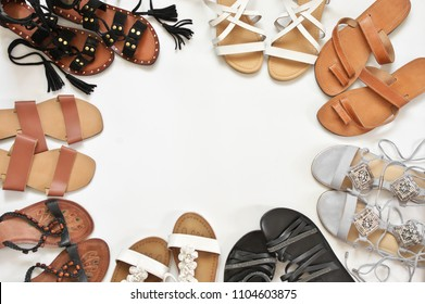Set of various leather sandals on white background. Casual summer footwear, top view point.