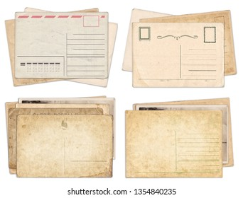 Set of various old vintage postcards isolated on white background