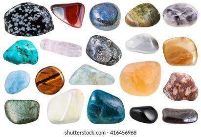 set of various polished natural mineral stones and gemstones - howlite, turquenite, obsidian, unakite, epidosite, apatite, leopardskin jasper, magnetite, kunzite, etc isolated on white background