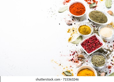 Set of Various spices in a bowls on white. Food background.