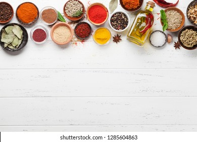 Set of various spices and herbs on wooden background. Top view with space for your recipe. Flat lay
