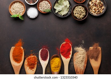 Set of various spices and herbs on stone background. Top view with space for your recipe. Flat lay