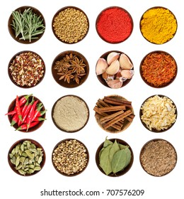 Set of various spices in round wooden bowl isolated on white background. Top view.