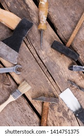 Set of various tools and instruments, top view. Top view of used tools on rustic wooden boards. Space for text.