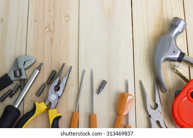 Set of various tools on wooden background with space for text. Construction concept