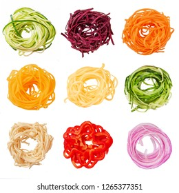 set of various vegetable noodles. spiralized zucchini, beets, pumpkin, squash, sweet potatoes, cucumber, vegetable banana, red pepper, red onion.  isolated on white background.