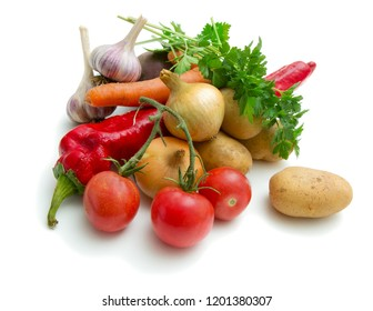 A set of vegetables collected from garden beds on white background