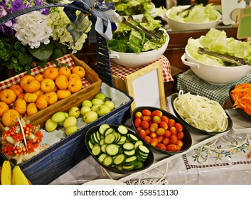 Set of vegetables and fruits for salad,tomatoes,cucumbers,carrots,onions,oranges and monkey apples.