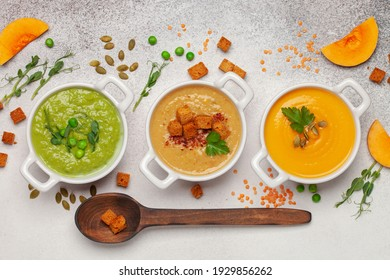 Set of vegetables soups. Pumpkin , green peas , lentil soup with ingredients. Dishes, food. Top view.