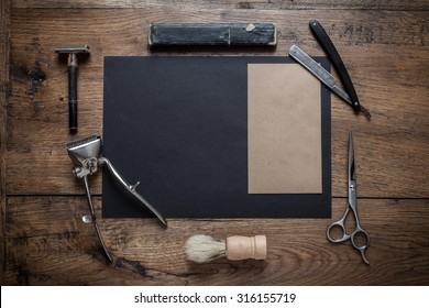 Set of vintage barber shoop equipment with black and kraft blank paper