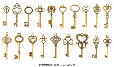 Set of vintage golden skeleton keys isolated on white background