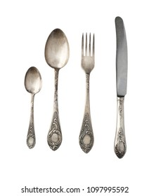 Set vintage spoons, forks and knives isolated on a white background. Retro silverware.