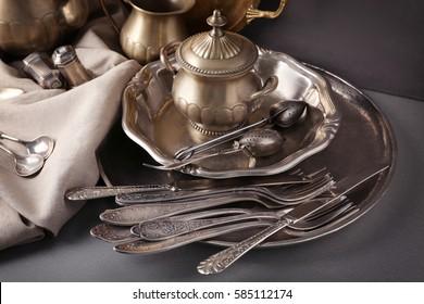 Set of vintage tableware on gray background