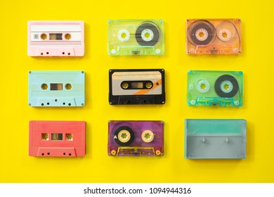 Set of vintage tape cassette recorder on yellow background, flat lay, top view. retro technology