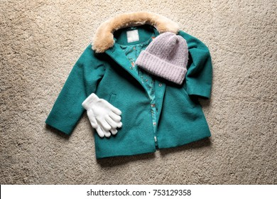 Set of warm child's clothes on fabric