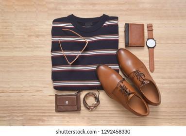 Set of warm striped sweater, handbag, shoes,watch, purse,belt, on wooden background