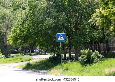 set warning road sign on pedestrian crossing