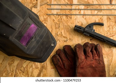 set of  welder tools on wood background . flat lay tools working space for welder , top view