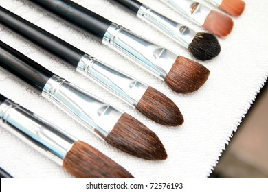Set of wet make up brushes on towel, close up