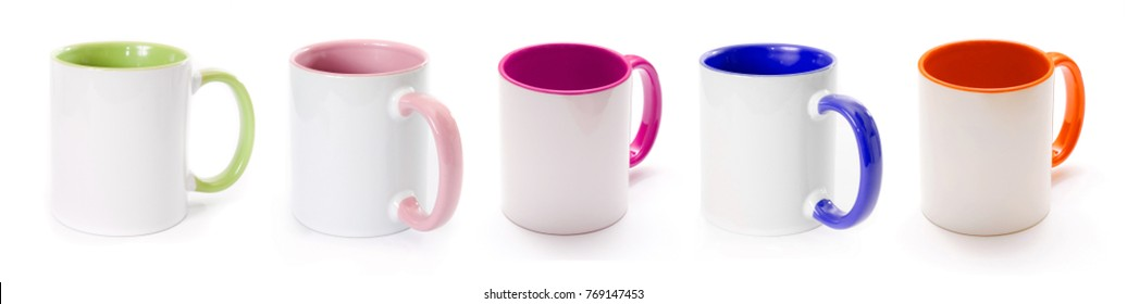 Set of white glossy cups with coloured handles isolated on white background