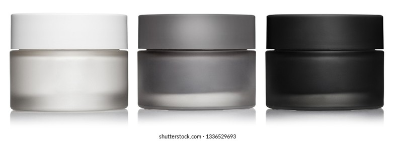 Set of white, gray and black cosmetic cream jars, isolated on white background - Shutterstock ID 1336529693