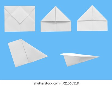 Set of white paper plane on blue color background with clipping path. business concept.