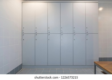 set of white plastic locker in swimming bathroom