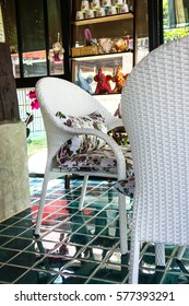 a set of white rattan furniture in a coffee shop