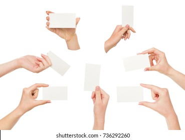 Set of white woman's hands holding white empty business cards with copy space. Isolated at white background