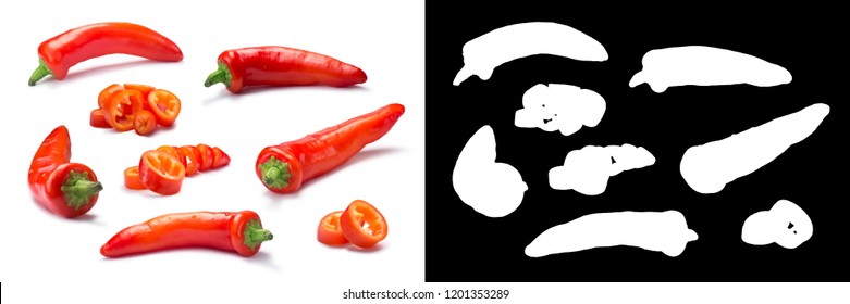 Set of whole and chopped orange Hungarian Hot Wax pepper or paprika (Capsicum annuum). Clipping path for each pepper, shadows separated